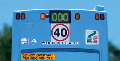 Slow down when bus lights flash