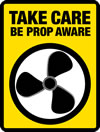 logo of a 3 bladed propeller with yellow background and text 'Take care - Be prop aware'