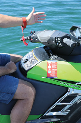 A kill switch lanyard attached to your arm stops the engine if you fall overboard