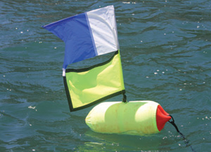 Example of a florescent float and flag, used to draw attention to the blue and white Alpha flag attached above them.