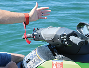 Kill switch lanyard worn around the rider's wrist on personal watercraft, to automatically stop the engine if the rider falls overboard.