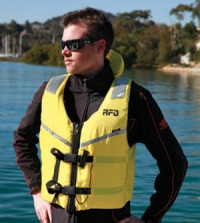 Example of a man wearing a 100+ non-inflatable lifejacket.