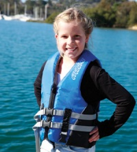 Example of a woman wearing a level 50S lifejacket.