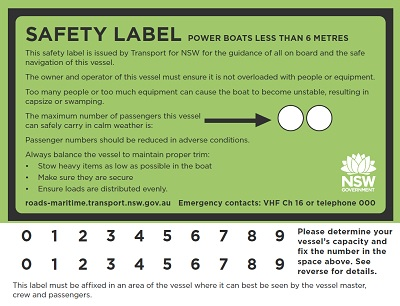 Green Safety label with black border showing carrying capacity of vessel