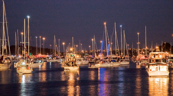 Brightly lit boats on the harbour