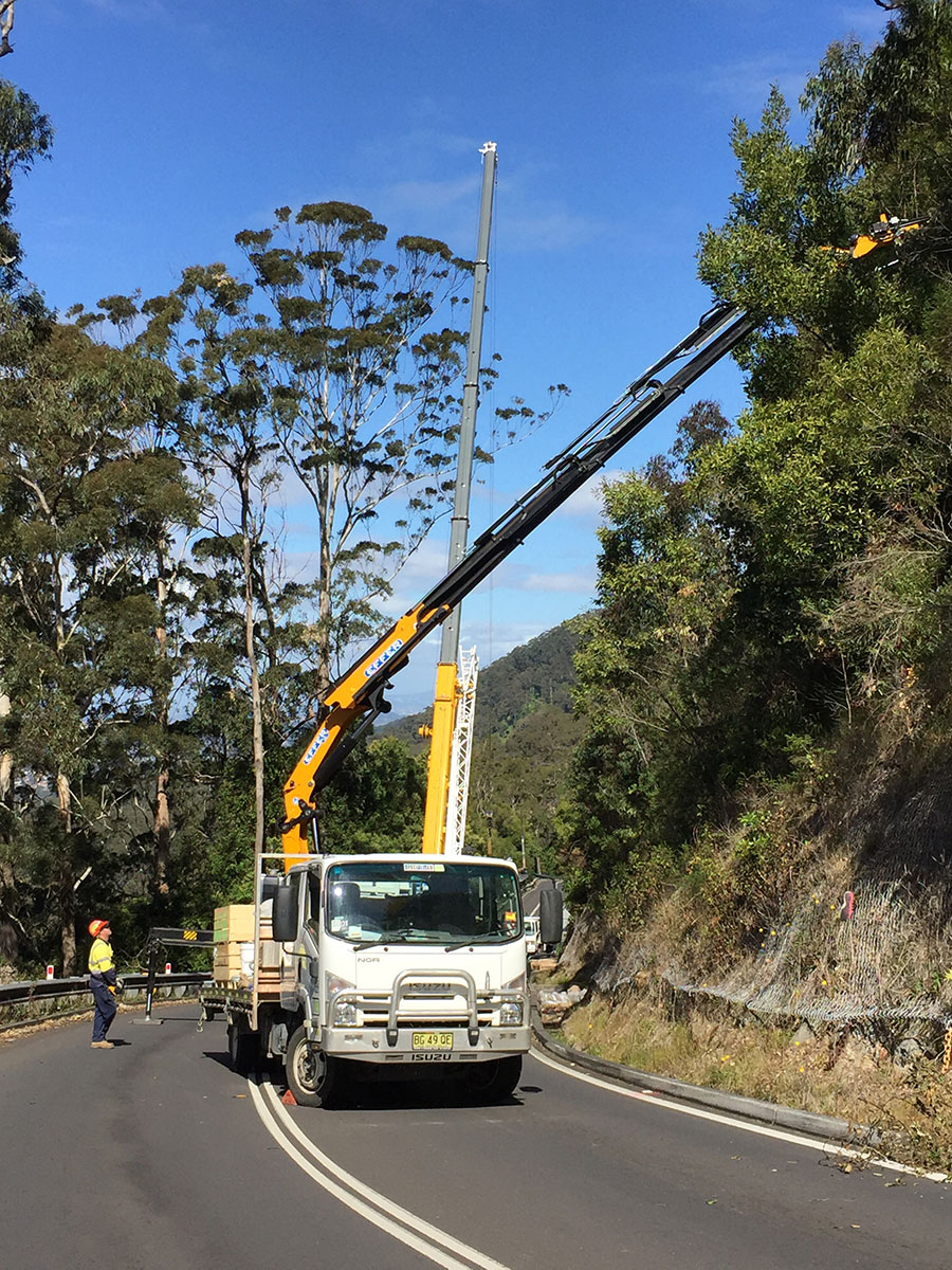 Stage 2 - Cranes lifting rock fall protection barrier components into position above Bulli Pass