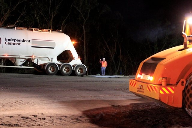 Nightwork on reverse curves with cement truck