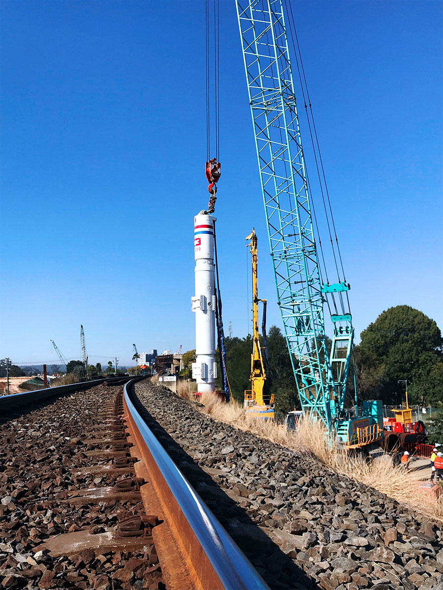 Train passenger view of piling occurring for the new Pound Street rail bridge (August 2018)