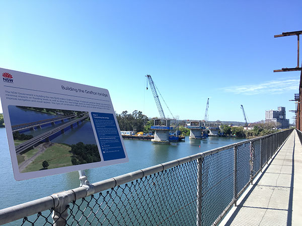 Signage on the existing bridge explaining the building of the new bridge (October 2018)