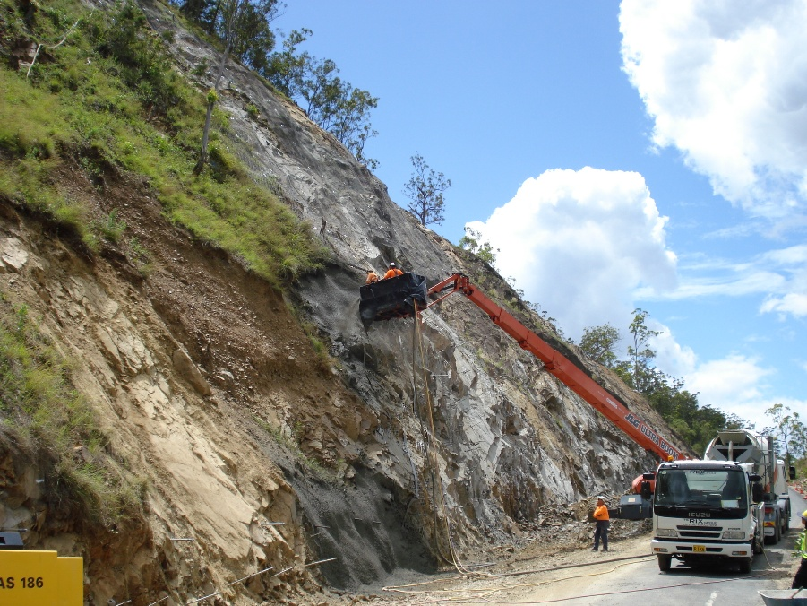 Slope stabilisation on Gwydir Highway - two workers in a cherry picker mounted on a truck.