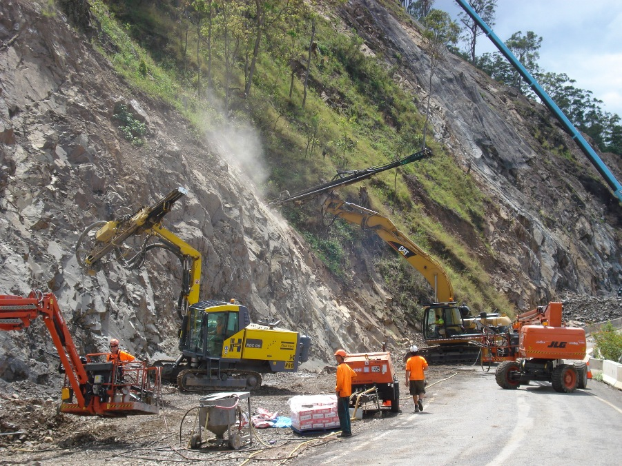 Slope stabilisation on Gwydir Highway - workers use heavy equipment to drill into the slope