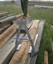 Photo of the plank lifting tool in operation