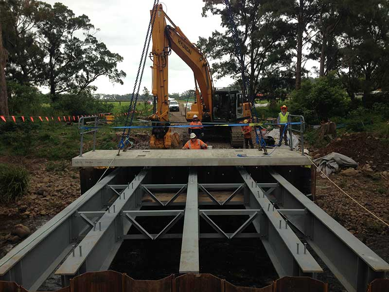 Precast concrete being placed on temporary bridge at Broughton Creek - February 2015