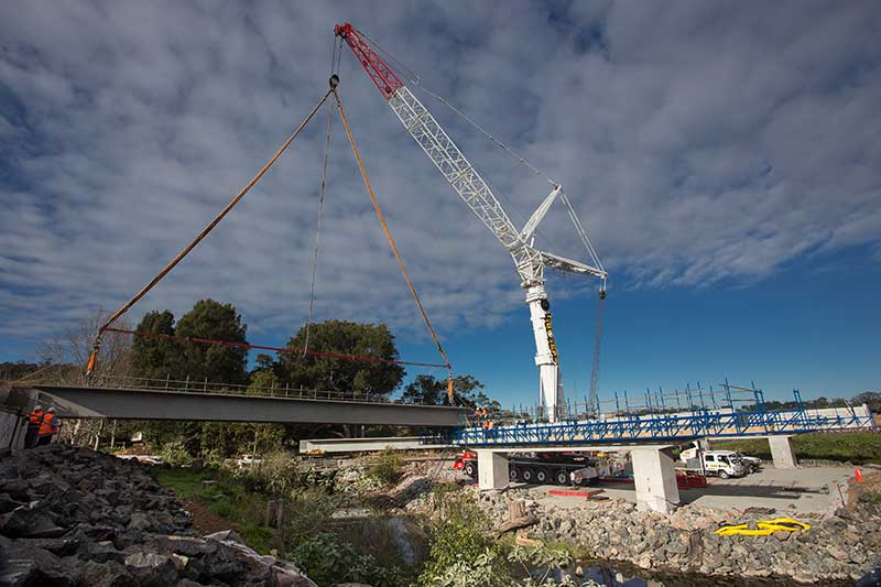 The 500 tonne crane placing the first bridge girders on Broughton Creek Bridge site number 1 (July 2015)