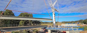 View time lapse footage of bridge girders (beams) being craned into place at Broughton Creek Bridge.