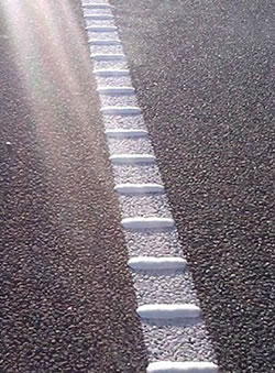 Profile line marking - raised markers indicate the edge of the road as a warning to drivers.