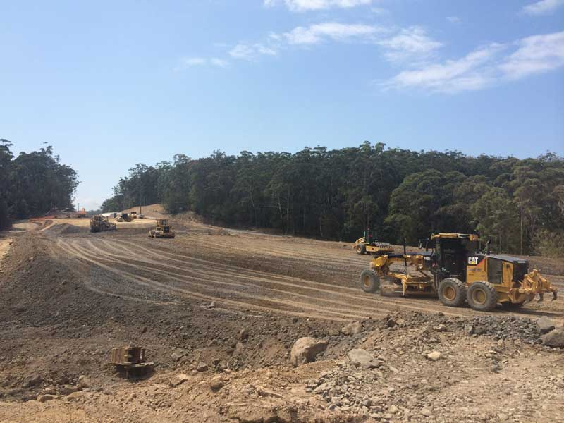 Looking north, a large embankment under construction for the new Princes Highway alignment (Oct 2015)