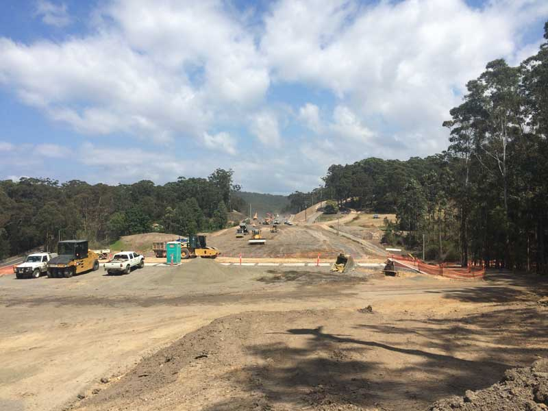 Looking south, a large embankment under construction for the new Princes Highway alignment (Oct 2015)