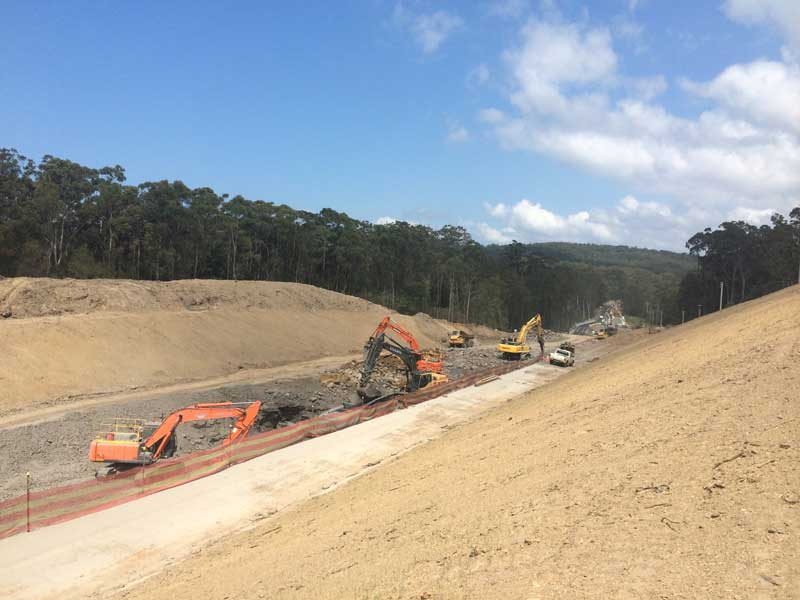 Looking south, a large cutting under construction for the new Princes Highway alignment (Oct 2015)