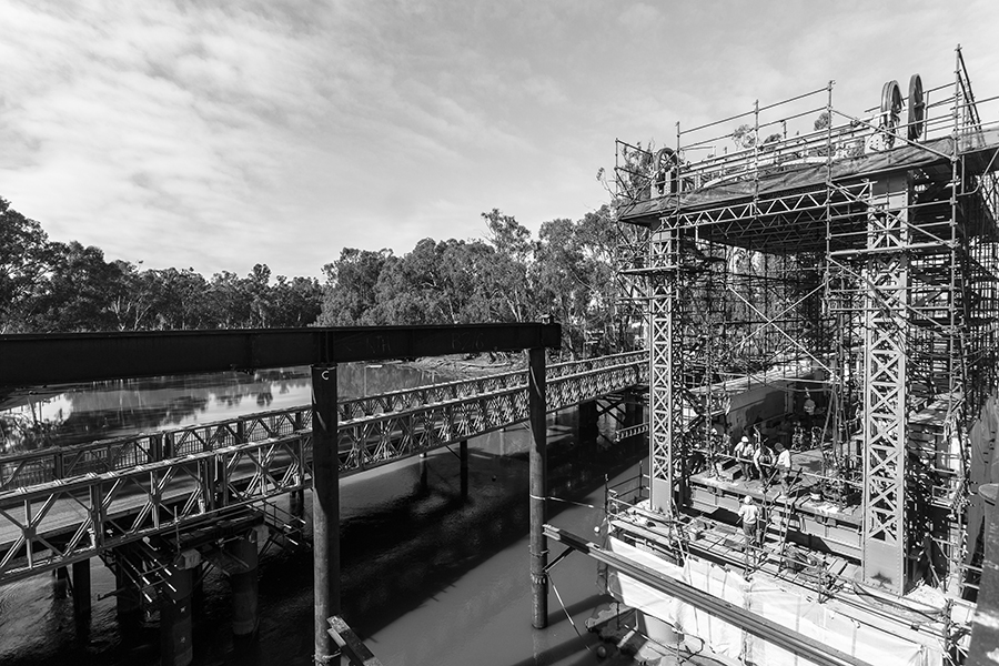 Workers prepare for the installation of the NSW truss span