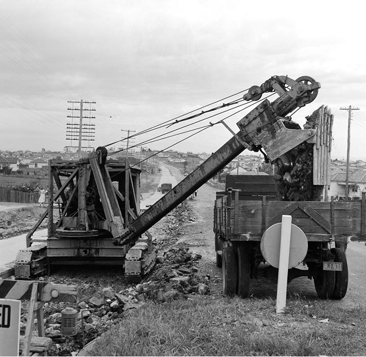Excavator working on reconstruction of Hume Highway near Bass Hill [Mar 1952]
