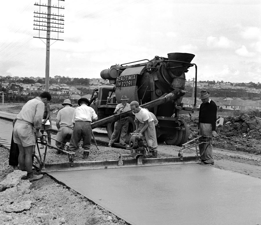 Reconstruction of highway near Bass Hill. Transverse screeding with vibrator attached to screed. [Ma