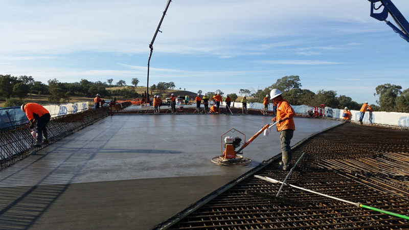 Placement of concrete on the bridge deck at span two