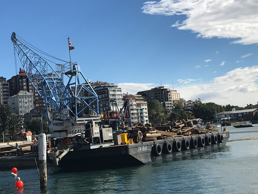 Barge with timber removed from structure