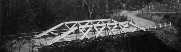 black and white photo of a timber bridge