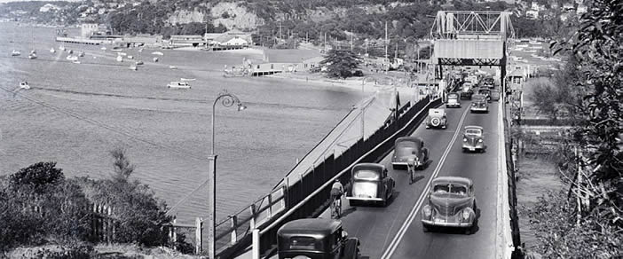 black and white photo of Spit Bridge closed with cars crossing