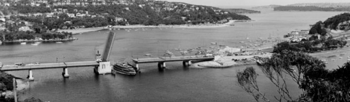 black and white photo of Spit Bridge open with a boat passing through the gap