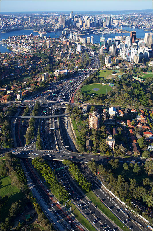 Aerial view of the Warringah Freeway, looking south towards North Sydney, the harbour and the city