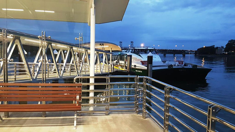 A RiverCat moored at the end of the gangway, viewed from the passenger waiting area of the new Meadowbank Wharf, at dusk.