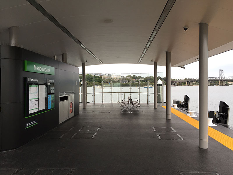 Daytime view of the passenger waiting area at the new Meadowbank Wharf, showing the information displays on the left.