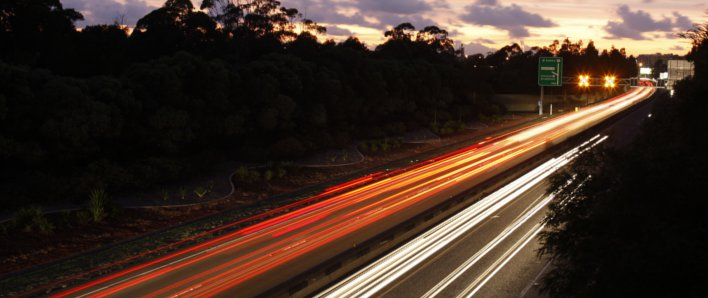 Traffic on the M4 Motorway at dawn, with 'streaking' effect of the vehicles' lights