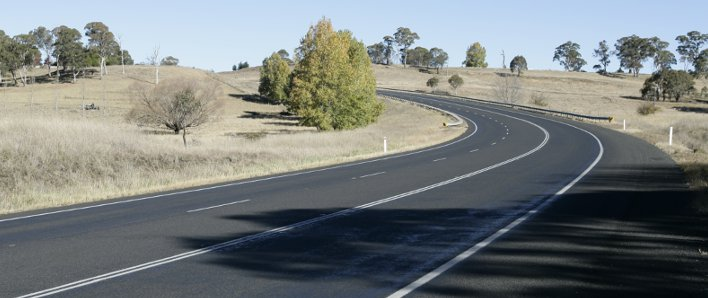 A sweeping bend on The Northern Road, with no vehicles visible.