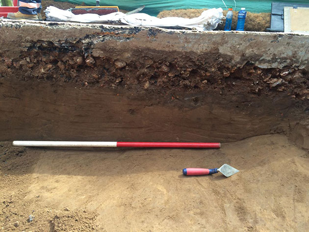 A typical historical test pit excavation, showing various soil layers