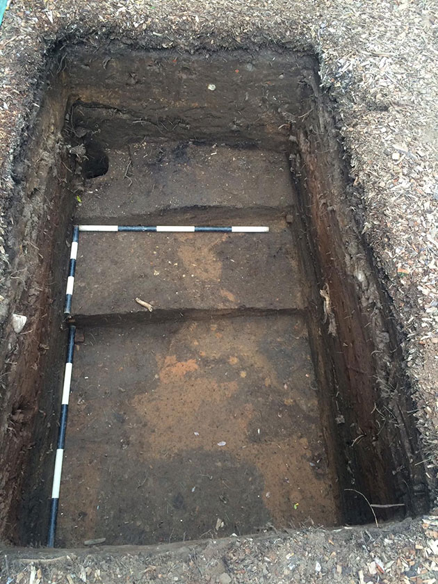 An Aboriginal test pit excavation, showing some historic archaeology features, including a posthole
