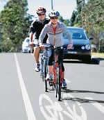 Bicycle rider using a marked bike lane.