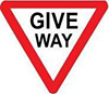Example of a give way sign, reading GIVE WAY in black text on an inverted triangle with a red border and white interior.