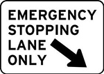 Example of a motorway sign reading EMERGENCY STOPPING LANE ONLY in black text on a white background, with a black arrow pointing to the lane.