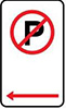 Example of a No Parking area sign, showing a black letter P in a red circle with a diagonal strike-through, on a white background.