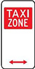 Example TAXI ZONE sign, with white text on a red square, shown on a white sign with arrows indicating the direction of the zone.