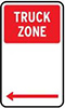 Example TRUCK ZONE sign, with white text on a red square, shown on a white sign with arrows indicating the direction of the zone.