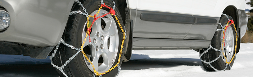 Snow chains on a car on an icy road