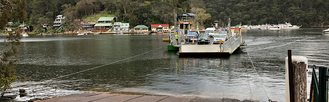 Berowra Waters Ferry arriving at the east bank, Berowra Creek.