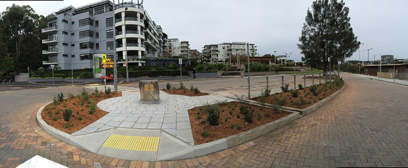 Panoramic view of the interchange at the new Meadowbank Wharf, showing new paving and gardens.